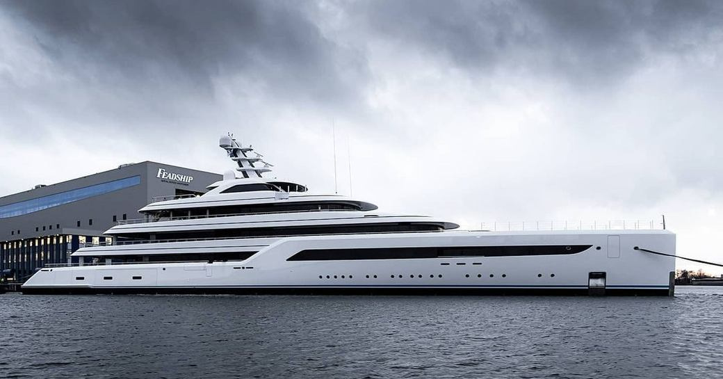 Feadship Project 816 on water outside fitting shed in Amsterdam