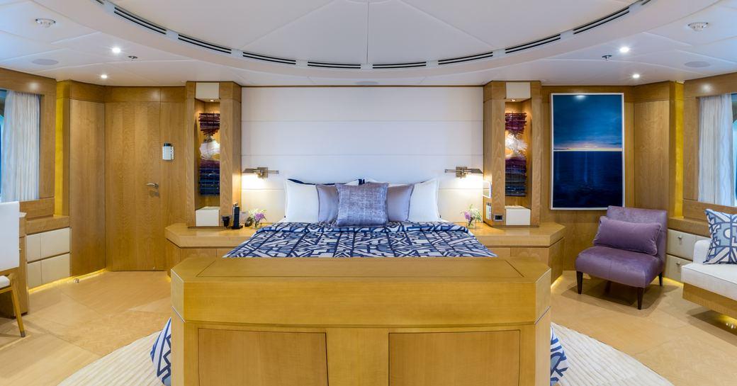 Large cabin on Superyacht BACA with bed and chairs either side