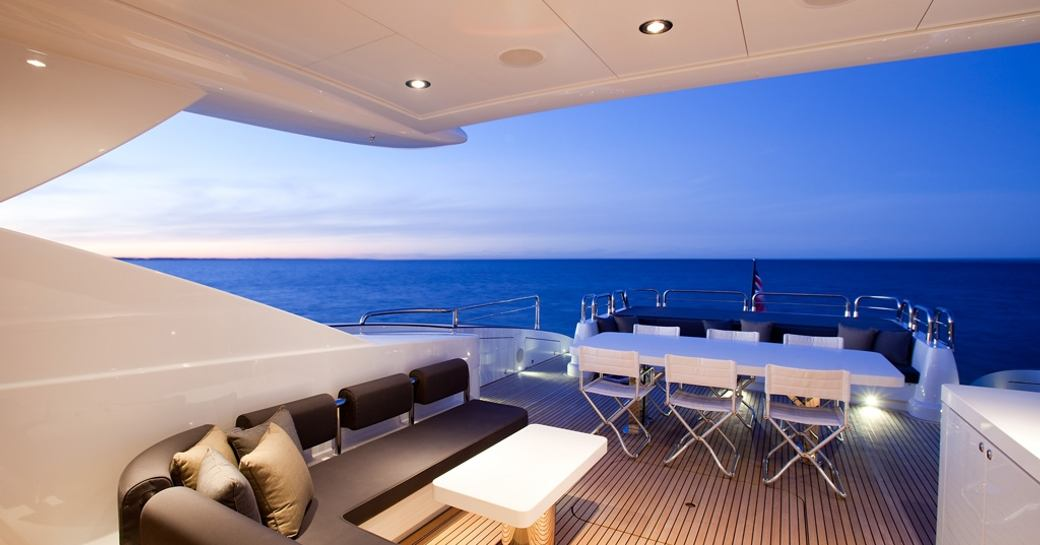alfresco lounge and dining on aft deck of motor yacht QUANTUM