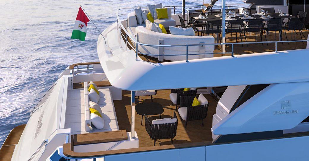 view of main deck aft and upper deck aft with seating and dining options on board charter yacht December Six
