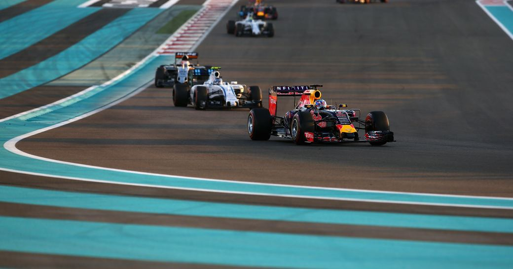 Car in the lead as it rounds the corner of the racetrack during Abu Dhabi Grand Prix with blue lines on the ground