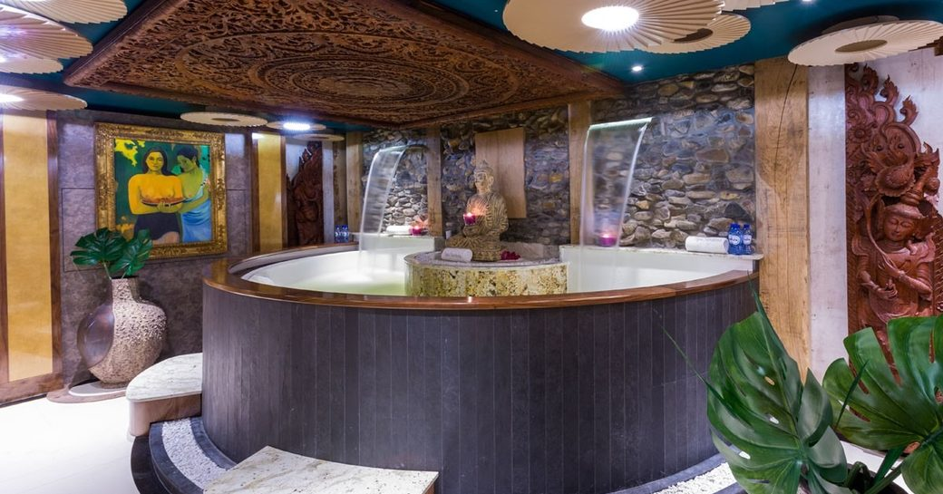 A Jacuzzi with Eastern decoration and two waterfall features