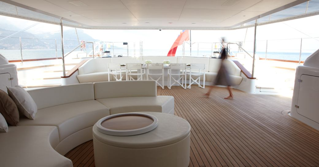 aft deck of sailing yacht panthalassa, with seating and al fresco dining