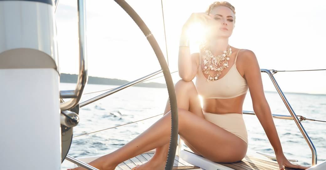 A charterer reclines on a luxury yacht