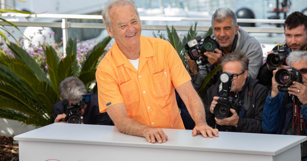 Bill Murray surrounded by photographers at Cannes Film Festival.