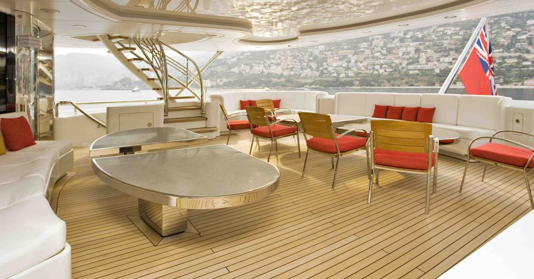 An al fresco dining table and seating arrangement on the exterior of luxury yacht 'Lady S'