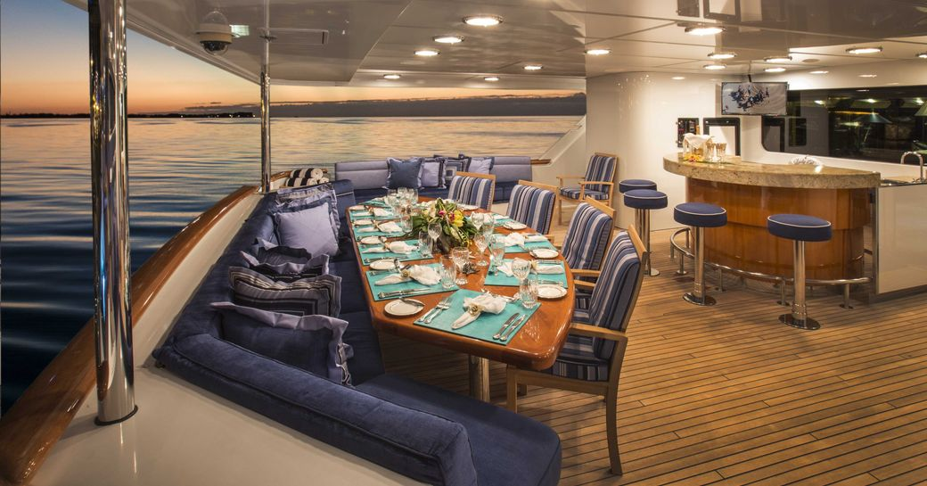 alfresco dining area and bar on the main aft deck of superyacht 'Lady Bee'