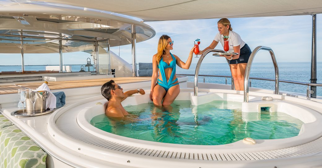 guests enjoying cocktails in superyacht jacuzzi