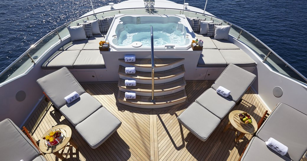 Sundeck with Jacuzzi and chaise loungers on board superyacht Zoom Zoom Zoom