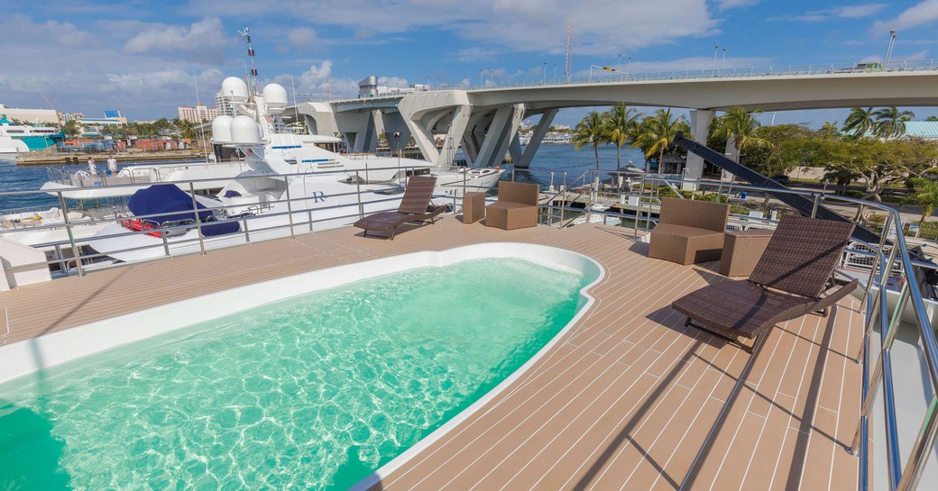 inviting swimming pool on the sundeck of charter yacht GLOBAL