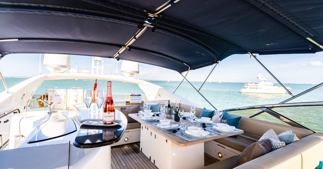 sundeck on luxury yacht chess, with champagne on table