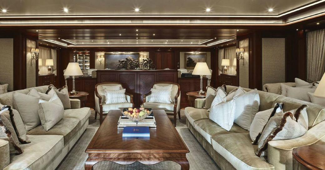 Main salon with plush seating aboard luxury charter yacht ARETI
