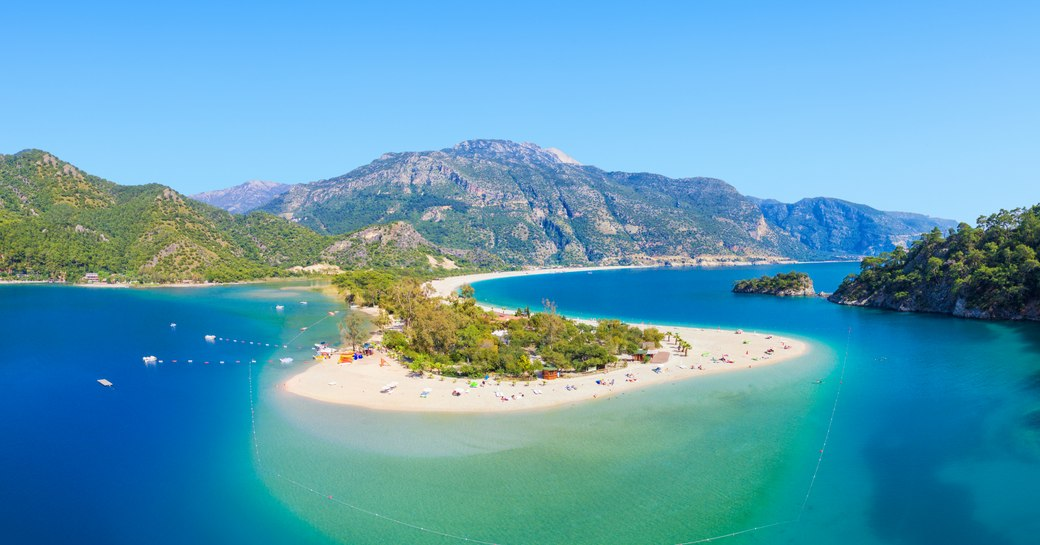 Aerial view of blue lagoon and pebble beach in Oludeniz, Fethiye district, Turquoise Coast of southwestern Turkey. Sunny summer day with clear blue sky in Oludeniz.Aerial view of blue lagoon and pebble beach in Oludeniz, Fethiye district, Turquoise Coast of southwestern Turkey. Sunny summer day with clear blue sky in Oludeniz.  Save  Try  Share Facebook Twitter Copy link Email Large • 4750 × 2670 pixels  40.2 × 22.6 cm • 300 DPI • JPEG   Select size / format Select license type   Standard License Included in plan Limited usage in print, advertising, and packaging. Unlimited web distribution.   Enhanced License €99.00 Unlimited usage in print, advertising, packaging, and merchandising. Unlimited web distribution.  What's an enhanced license?  Download Edit this image Royalty-free stock photo ID: 1038719602  Aerial view of blue lagoon and pebble beach in Oludeniz, Fethiye district, Turquoise Coast of southwestern Turkey. Sunny summer day with clear blue sky in Oludeniz.