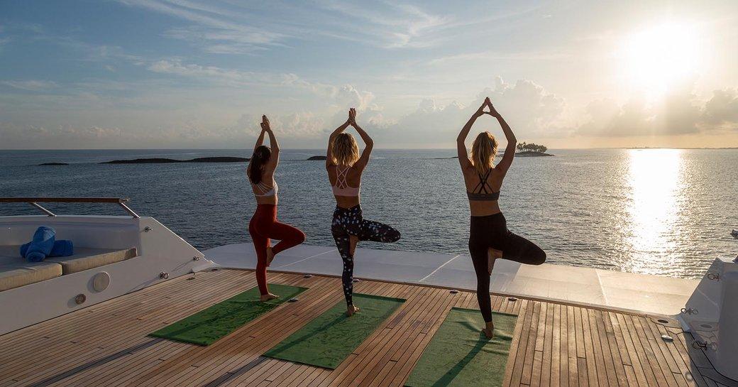 yoga on deck of luxury yacht