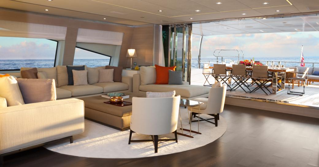 tranquil skylounge opens up onto alfresco dining area on board motor yacht Cheers 46