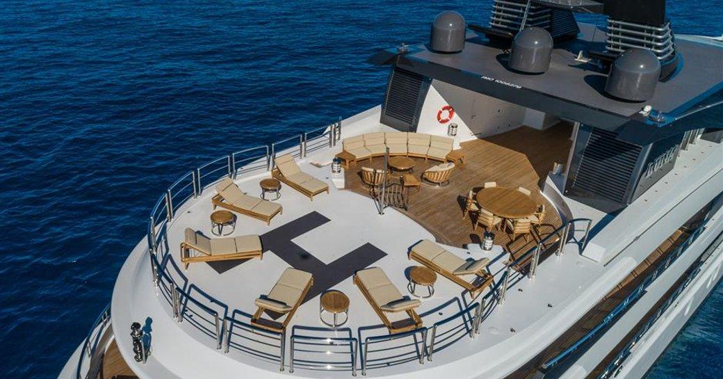 Aft helipad with sun loungers onboard MY Luna B