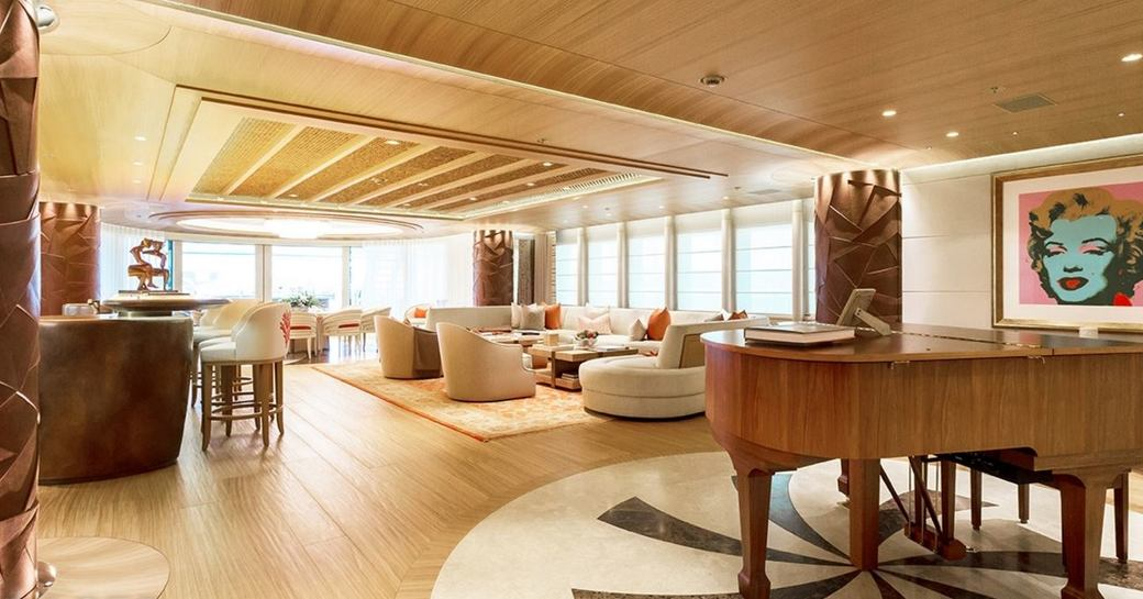 warm, welcoming and beachy main salon on board superyacht 'Here Comes The Sun'