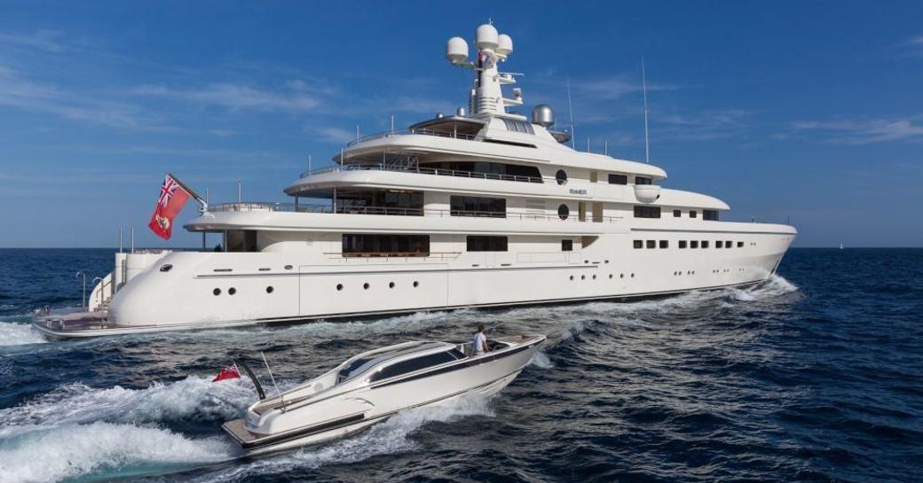 Abeking & Rasmussen superyacht ROMEA underway with attendant tender