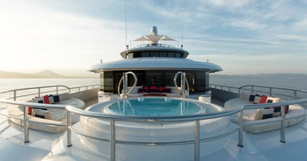 An image showing the Jacuzzi and sundeck of luxury yacht 'Mine Games'