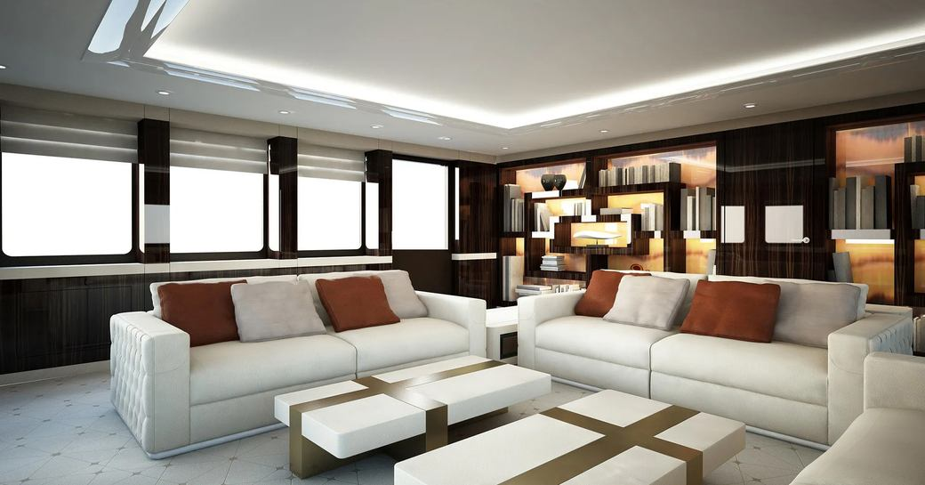 the private lounge with discreet lighting in the principal charterers accommodation inside superyacht SOARING by abeking and rasmussen