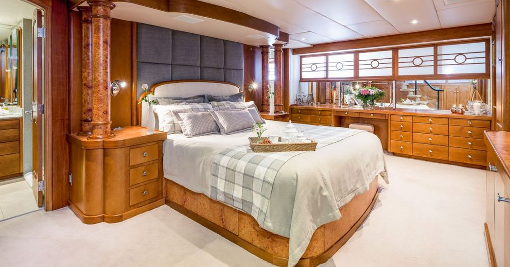 master cabin on luxury yacht daydream, with island bed and plenty of space surrounding