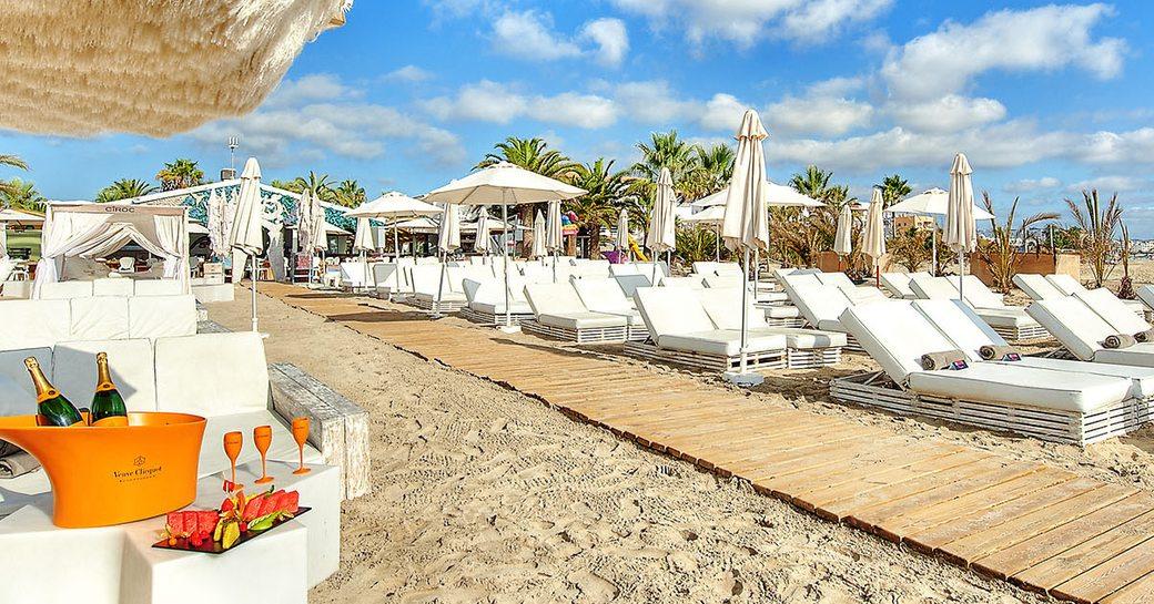 sun loungers lined up at Ushuaïa Beach Club, Ibiza