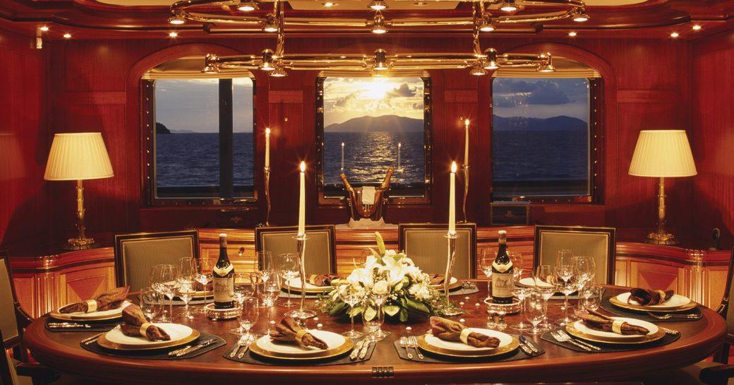 Formal dining on boad superyaht ATHENA