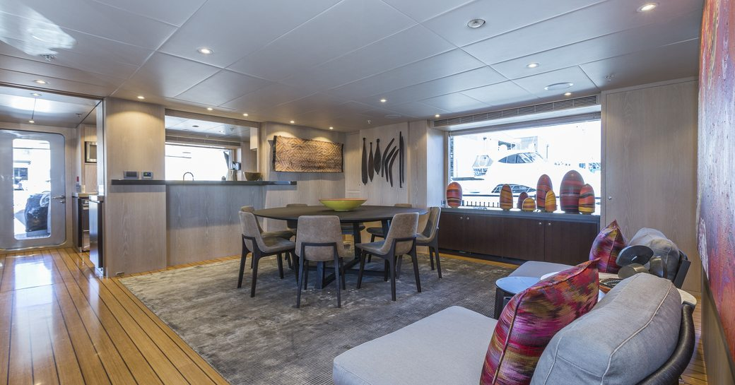 The modern furnishings which compose the interior of superyacht AKIKO