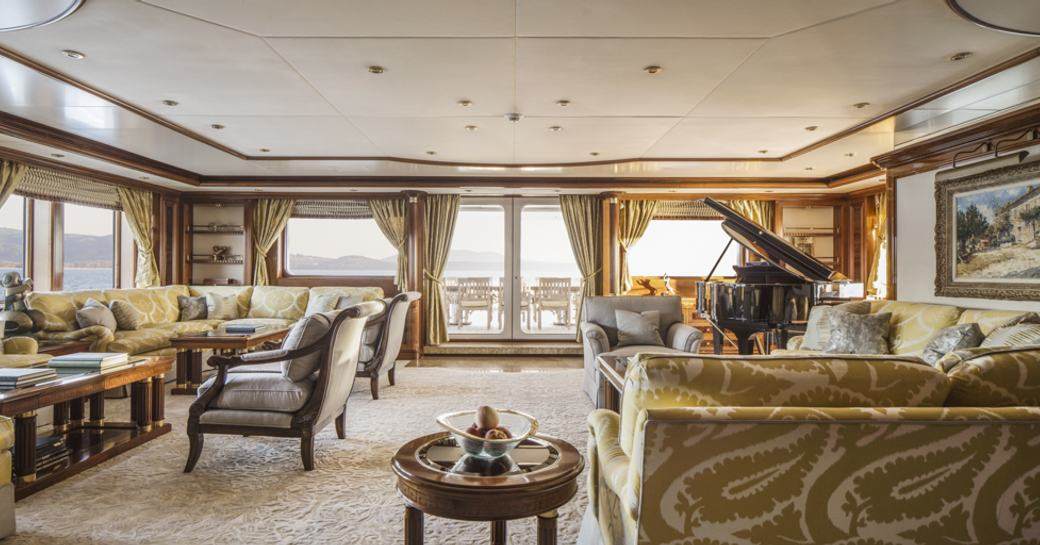 classically styled main salon with grand piano and sofas aboard superyacht TITANIA