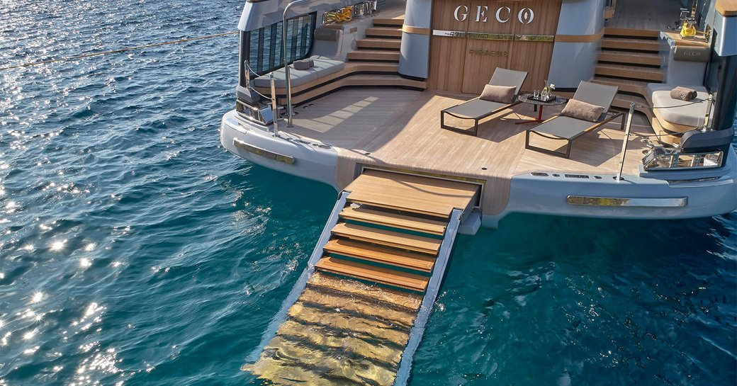 geco yacht with steps leading to the sea
