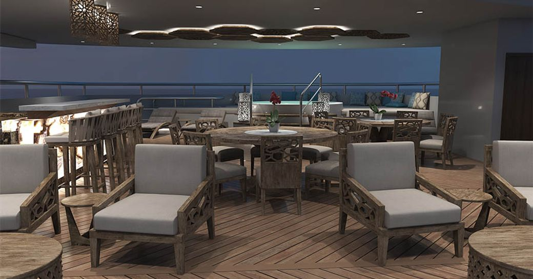 sun loungers, dining table, bar and spa pool on the sundeck of charter yacht ELITE