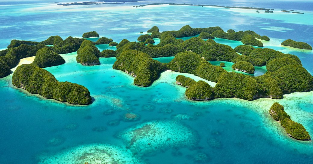 south pacific islands with bright blue sea and sandy beaches