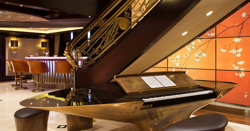 electric piano with video wall and bar on board motor yacht KISMET