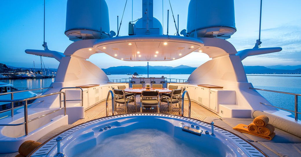 sundeck of superyacht magenta m, with spa pool and dining area