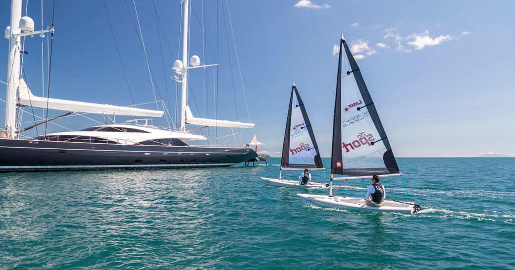 Guests enjoying sailing lasers onboard SY Twizzle