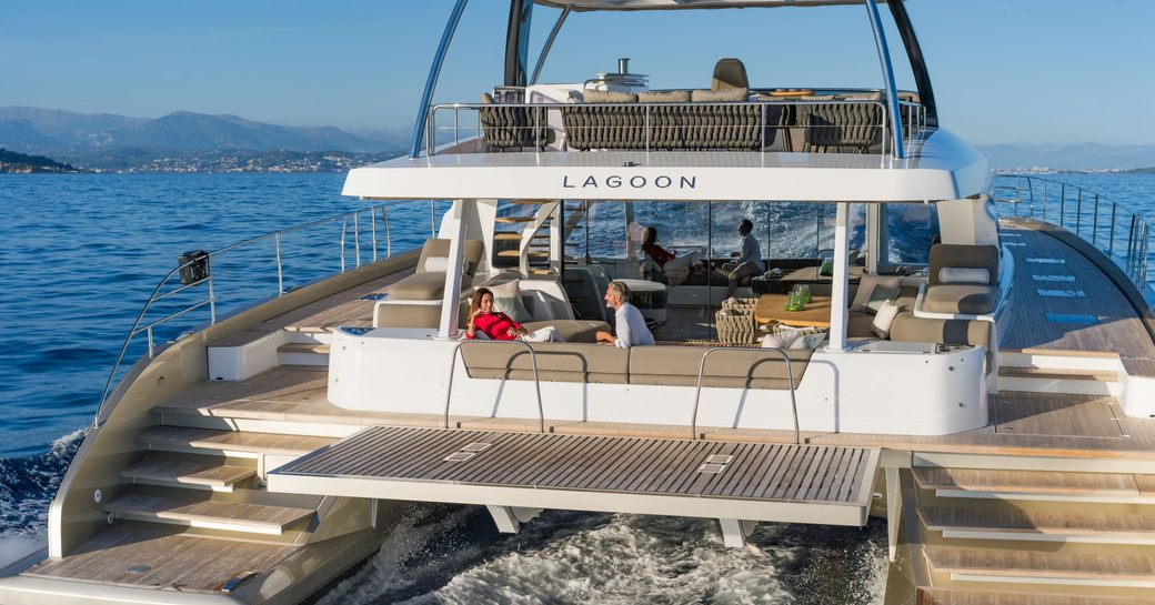 Social seating area al fresco on the deck of luxury yacht Double Down