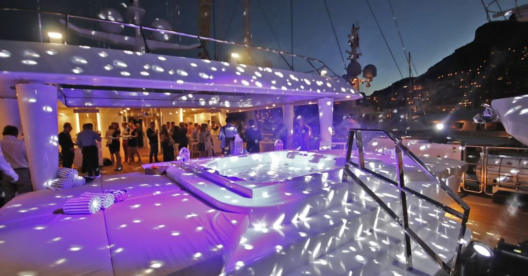 guests gather for a party on the sundeck of superyacht KATINA