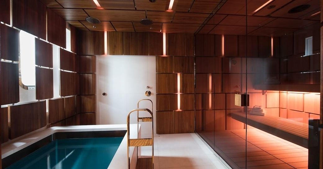 The plunge pool and sauna separated by a glass screen on motor yacht CLOUDBREAK