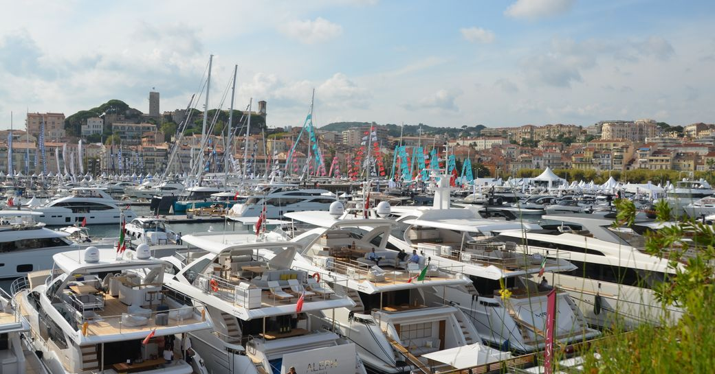 Yachts lined up in the harbour at Cannes Yachting Festival