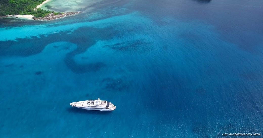 aerial view of luxury yacht silver angel against blue sea
