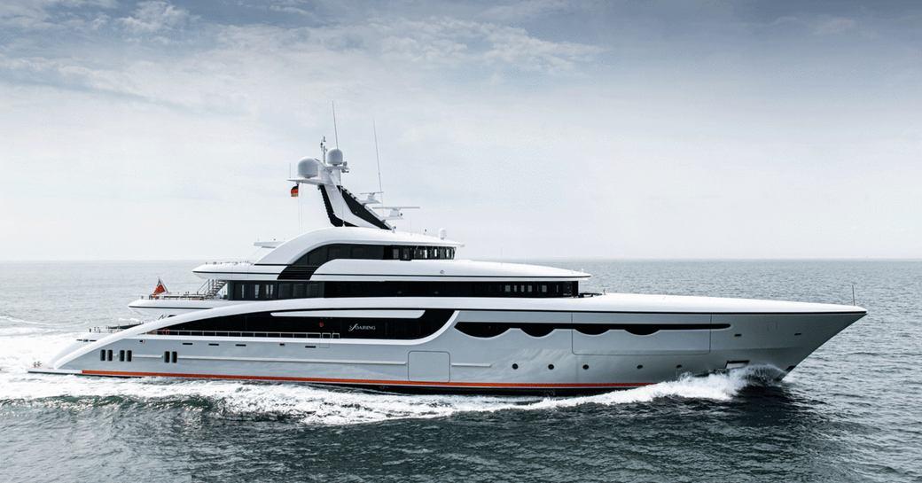 luxury yacht soaring running shot
