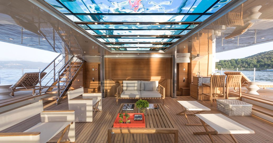 glass bottomed pool on luxury yacht lady lena, with beach club below
