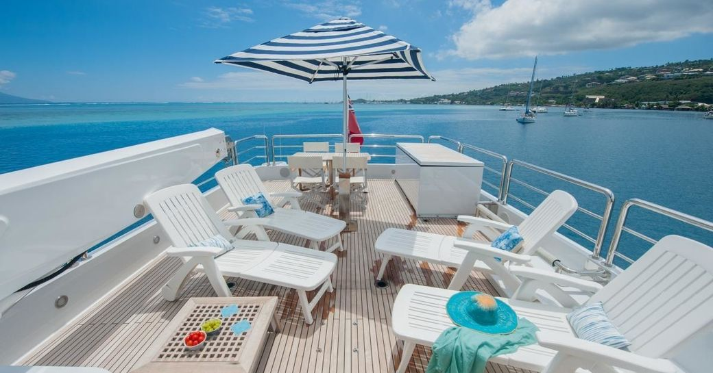 chaise loungers lined up on sundeck of superyacht DREAMTIME