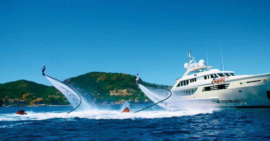 luxury yacht with jetpacks alongside