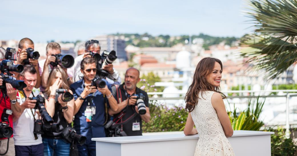 Woman standing in front of marina at Cannes Film Festival