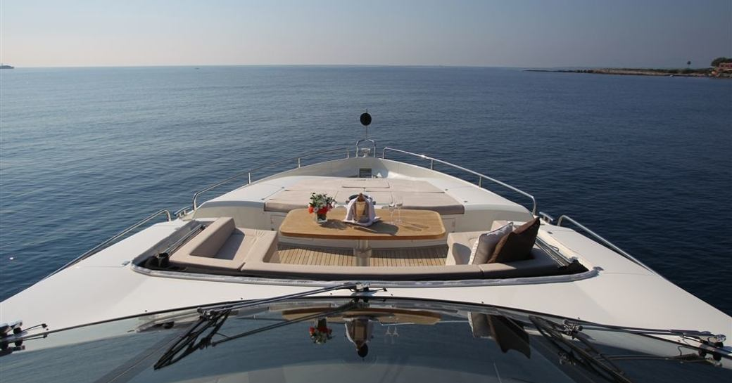 casual alfresco dining on foredeck of charter yacht FIRECRACKER