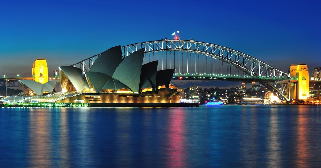 view of sydney opera house and harbour bridge from water
