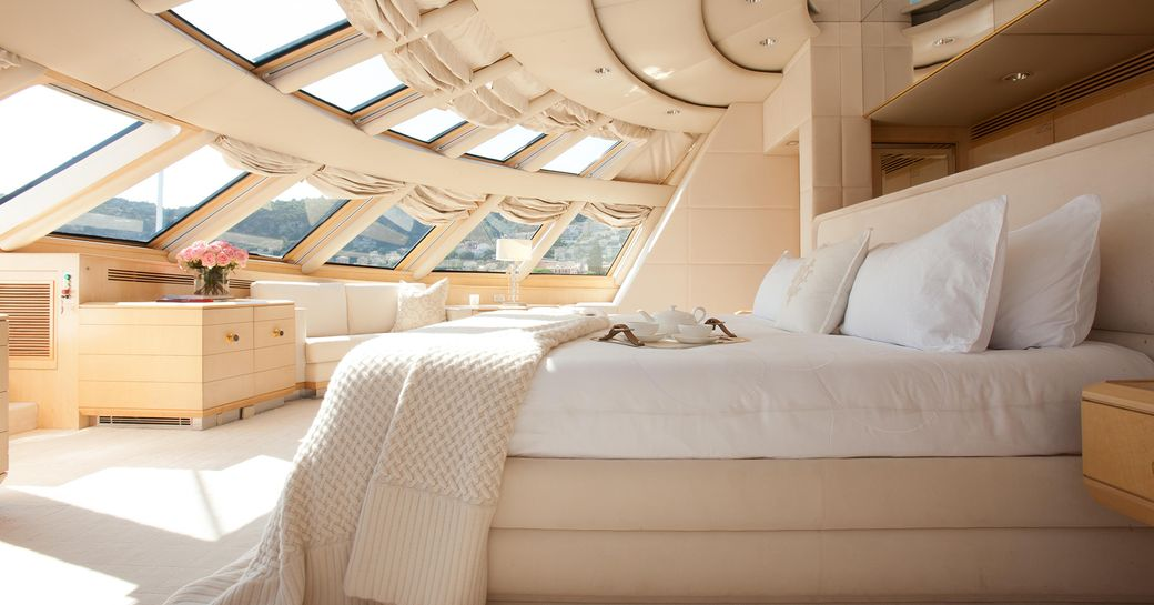 Main salon on superyacht AZZURRA II, with tall windows to allow plenty of light in