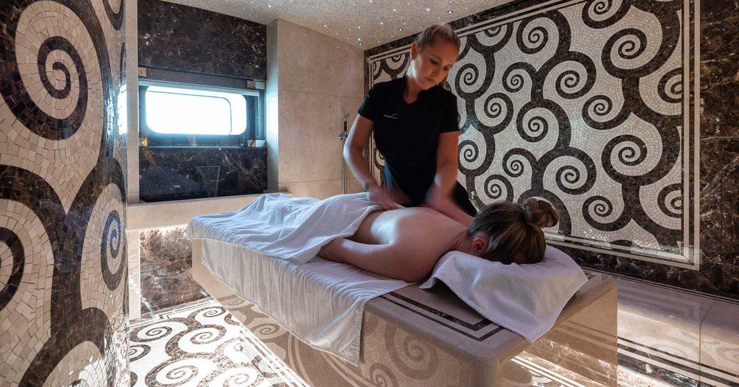 guest gets massage on superyacht lana