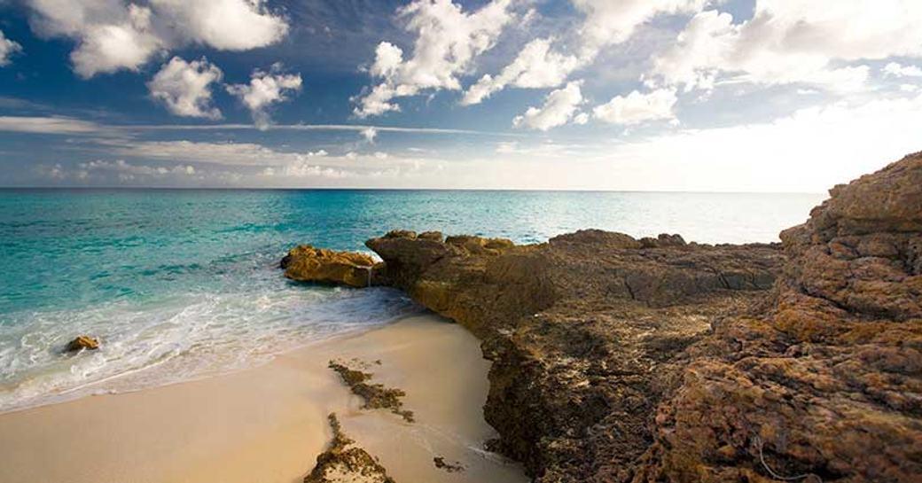 A rocky coastline and beach of Saint Martin